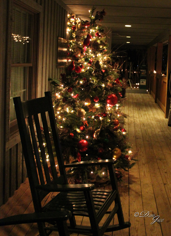 Christmas Tree on porch with rocking chair
