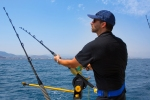 bigstock-blue-sea-fisherman-in-trolling-38770756