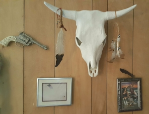 Wall decor, steer head, southwest pictures and a realistic looking western pistol