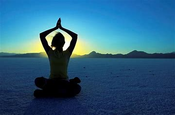 Picture: All Creative Commons Bing - Meditating on the sand with mountains in the background as sun rises